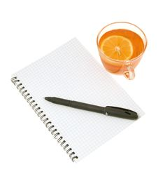 Notebook With A Pen And Tea With A Lemon Royalty Free Stock Photography