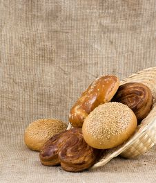 Free Panary Rolls Pour Out From A Basket Stock Photo - 23169470