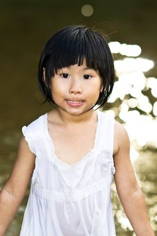 Little Asian Girl Wearing Wet Dress Royalty Free Stock Photo
