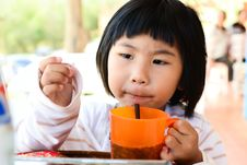 Free Little Asian Girl Holding Glass For Drink Royalty Free Stock Photo - 23173015