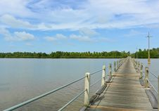 Free Long Wood Bridge Over A River Royalty Free Stock Image - 23174766