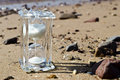 Free Crystal Hourglass On Marine Beach Stock Image - 23189541