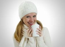 Girl In A Winter Hat And Scarf With Mug Of  Drink Stock Images