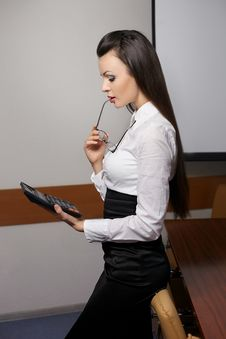Free Thinking Business Woman With Calculator In Office Stock Photo - 23184930