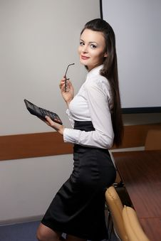 Free Smiling Business Woman With Calculator In Office Stock Photography - 23184932