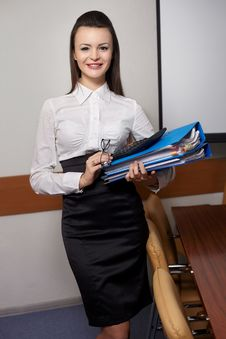 Smiling Business Woman At Office With Documents Royalty Free Stock Photos