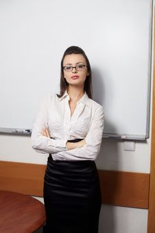 Businesswoman Standing Near Board  In Glasses Royalty Free Stock Images