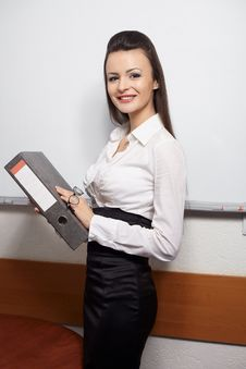 Smiling Businesswoman Standing Near Board Stock Images