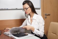 Business Woman Looking Trough The Documents Royalty Free Stock Images