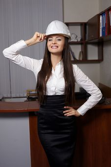 Free Young Business Woman Smiling N An Office Stock Photo - 23185160