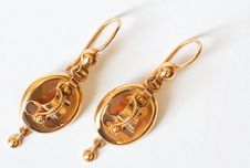 Free Two Golden Earrings Stock Images - 23187814