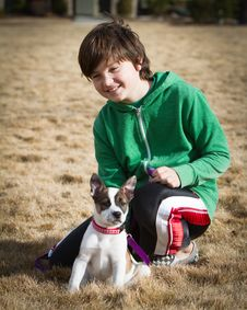 Boy With Cattle Dog / Boxer Hybrid Puppy Royalty Free Stock Photography