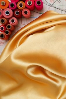Colored Bobbins And Golden Silk Royalty Free Stock Image
