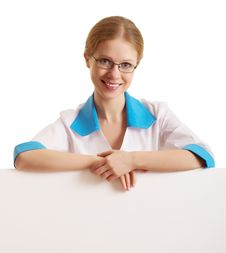Free Female Doctor Holding A Blank Billboard Royalty Free Stock Photography - 23196347