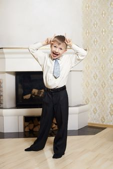Funny Little Boy Standing Near The Firepleace Stock Photos