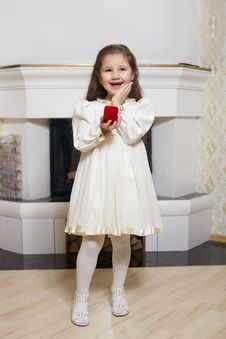 Free Smiling Girl In White Dress With Red Box Stock Photos - 23197553
