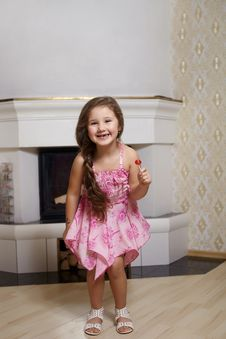 Free Smiling Girl In Pink Dress At Home With Sweet Stock Photography - 23197562