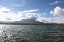 Free Dormant Volcano On The Lake Royalty Free Stock Photos - 23197568