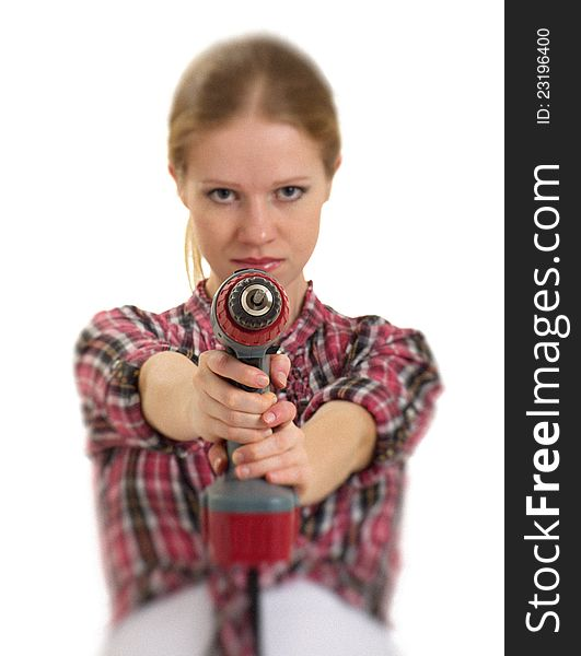 Young cheerful woman with cordless drill