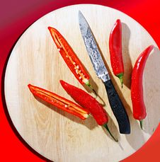 Free Chili Peppers And Knife Stock Photo - 2321700