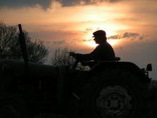 Shadow Of Farm Worker Stock Photos