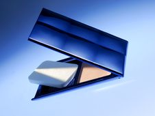 Cosmetic Powder In Blue Light Stock Image