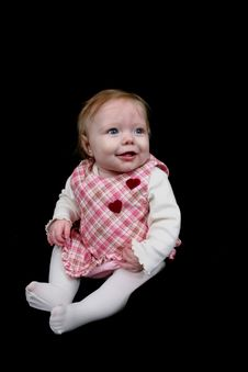 Cute Little Girl On Black Royalty Free Stock Photography