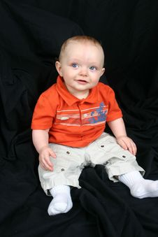 Cute Little Boy On Black Stock Photos