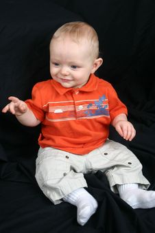 Cute Little Boy On Black Stock Images