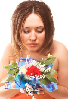 Free Woman Sniffing Flowers Royalty Free Stock Photos - 2324888