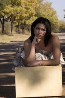 Free Sad Brunette With Suitcase Stock Photo - 2327160