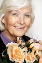 Free Senior Woman With Flowers Royalty Free Stock Photos - 23205028