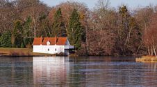 Free Whitewashed Lakeside Boathouse In Winter Sunshine Royalty Free Stock Image - 23207106