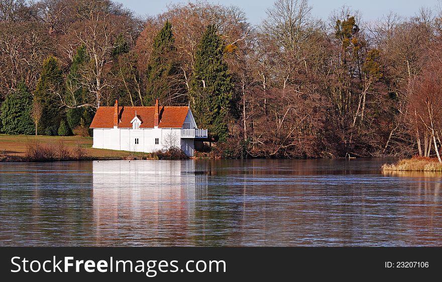 Whitewashed Lakeside Boathouse in Winter sunshine
