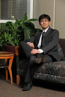 Young Eastern Businessman Sitting Stock Photography