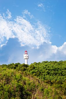 Free Lighthouse With Blue Sky White Clouds Royalty Free Stock Photography - 23223347