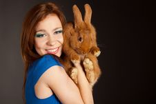 Portrait Of A Beautiful Woman With A Rabbit Royalty Free Stock Photo