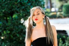 Beautiful And Fashion Girl With Pigtails Stock Photo