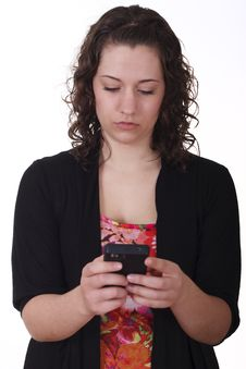 Free Young Brunette Serious Texting Stock Photography - 23239382