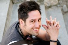 Free Handsome Young Man Smiling Royalty Free Stock Photography - 23242447