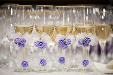 Champagne Glasses Decorated With Artificial Flowes Royalty Free Stock Images