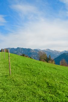 Free Meadow With Light Fence And Blue Sky Background Royalty Free Stock Photography - 23252087