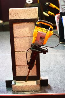 Free Yellow Demolition Hammer Breaking Brick Demo Stock Photos - 23252333