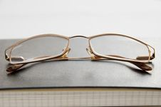 Free Glasses And Notebook Stock Images - 23269334