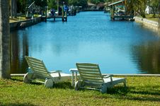 Two Empty Chairs By The Water Stock Photography