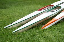Racing Kayaks On Grass Royalty Free Stock Photo