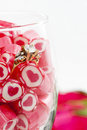 Free Diamond Ring And Candy In Wine Glass Stock Image - 23288101