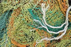 Free Old Tangled Fishing Nets Royalty Free Stock Images - 23284959