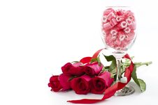 Free Candy In Wine Glass With Rose Royalty Free Stock Photos - 23287998