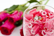 Free Diamond Ring And Candy In Wine Glass Royalty Free Stock Images - 23288039